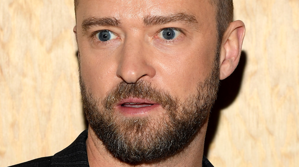 Justin Timberlake staring into the distance with a blank look