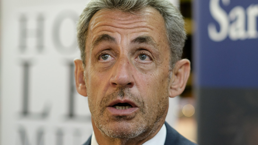 """Former French President Nicolas Sarkozy signs his latest book """"le temps des tempetes"""" in a bookstore on September 3, 2020 in Brussels, Belgium."""
