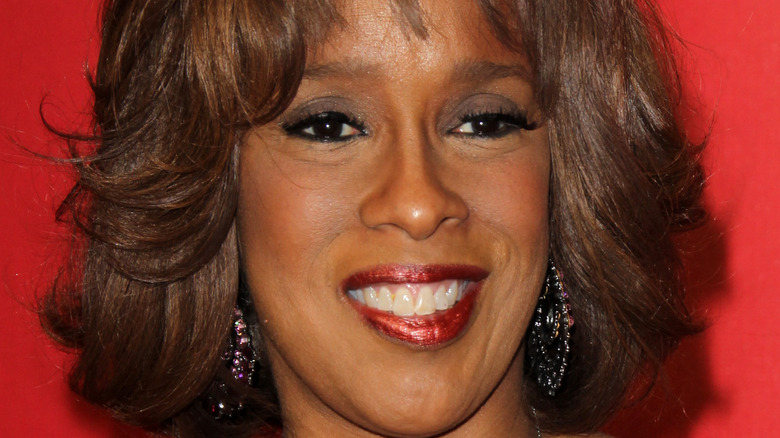 Gayle King smiles at an event