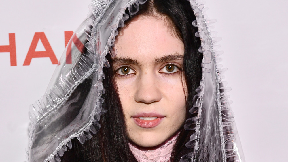 Grimes posing at a red carpet event