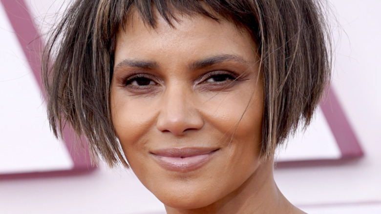 Halle Berry in a short bob haircut with bangs, smiling