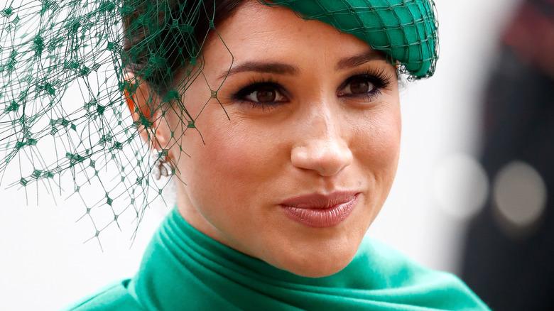 Meghan Markle wearing a green fascinator