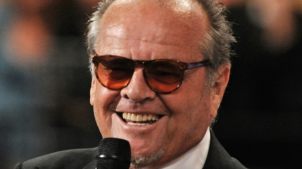 Jack Nicholson with microphone in hand