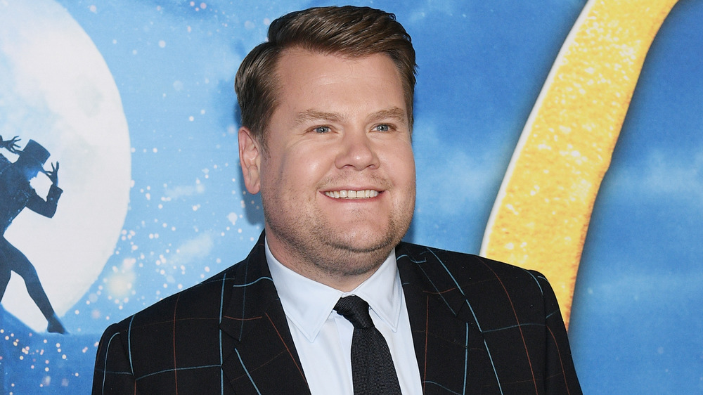 James Corden smiling on the red carpet
