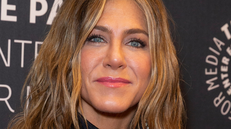 Jennifer Aniston smiling lips closed