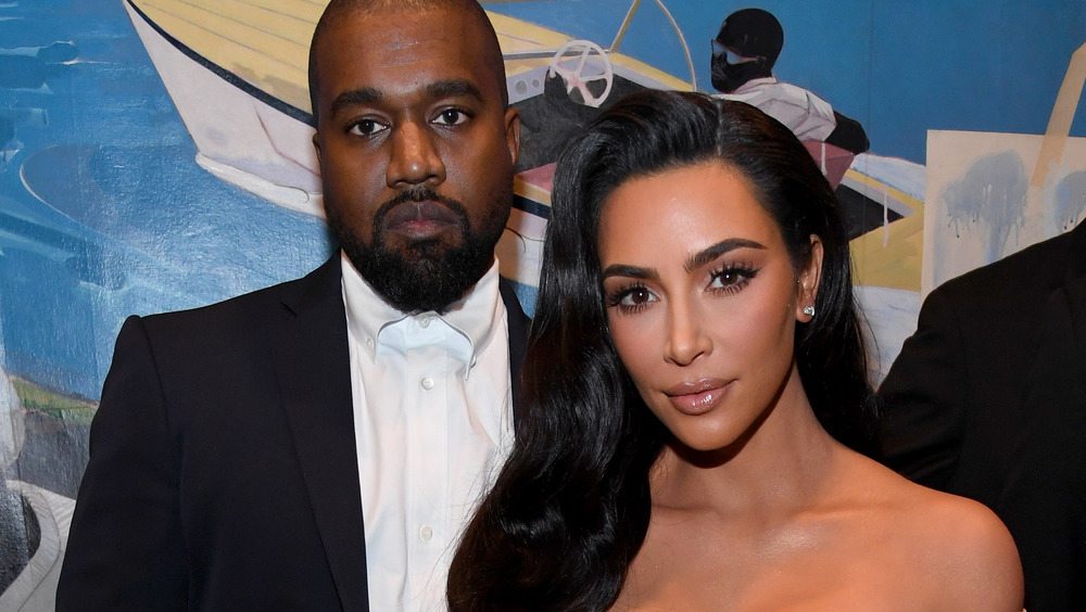 Kim Kardashian and Kanye West on the red carpet looking serious
