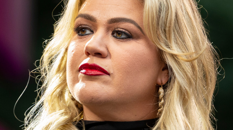 Kelly Clarkson looking to the side with serious expression