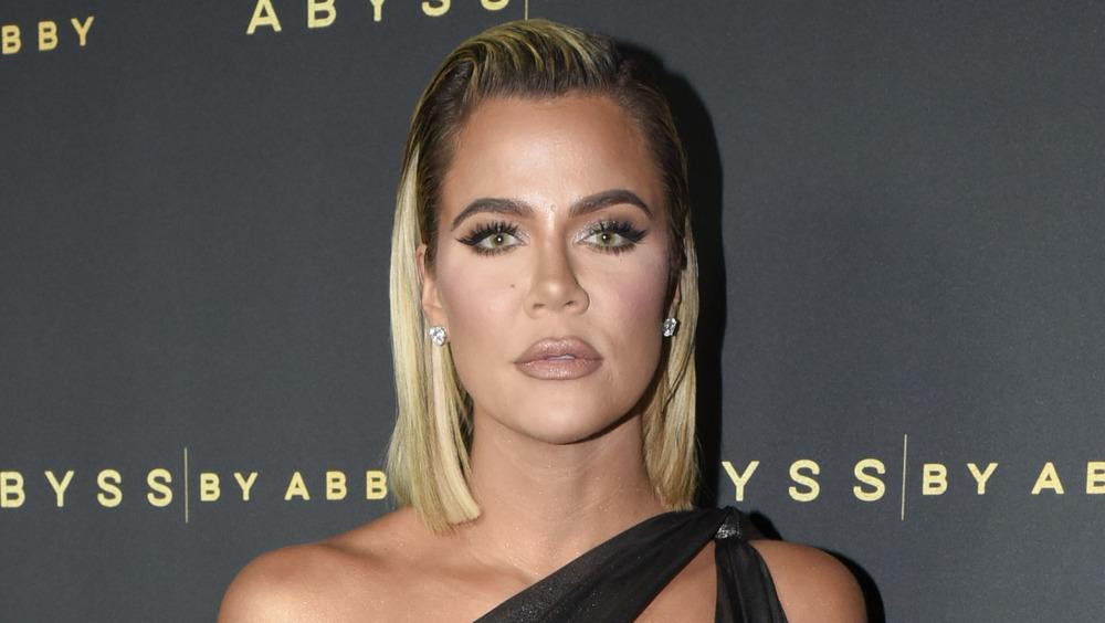 Khloe Kardashian poses at an event