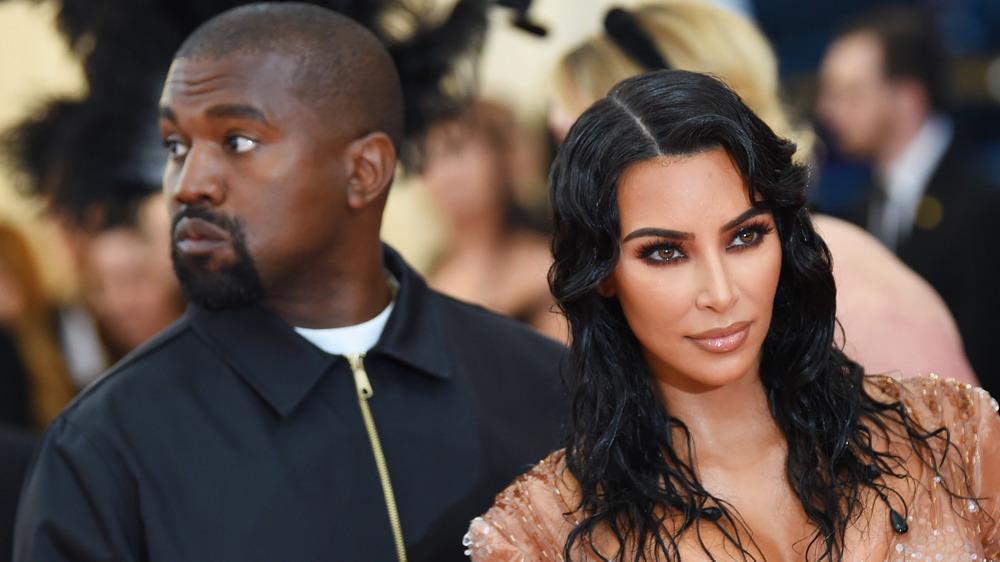 Kim Kardashian-West, Kanye West, posing