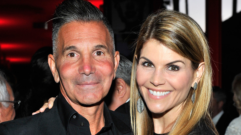 Mossimo Giannulli  and Lori Loughlin pose at a party