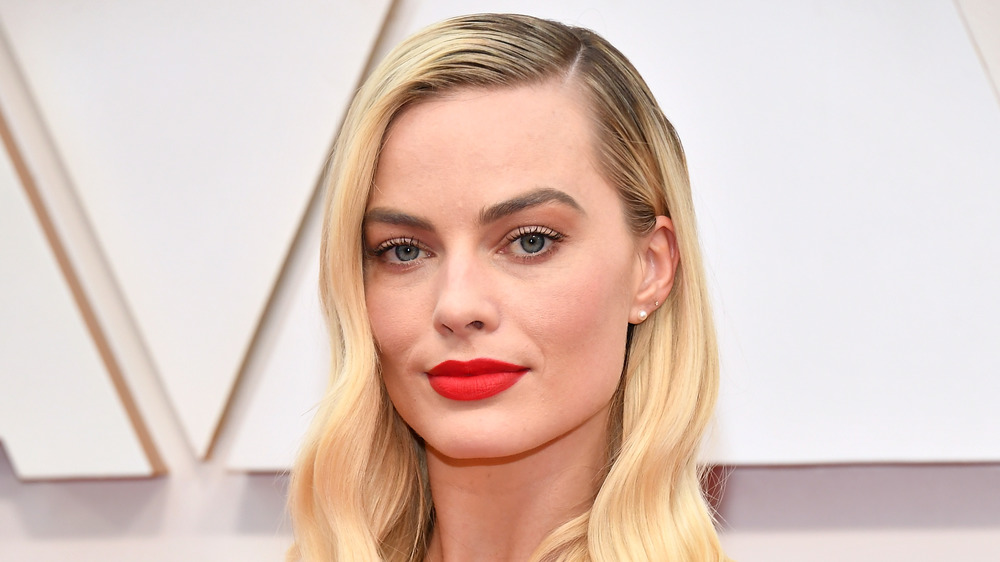 Margot Robbie with a serious expression