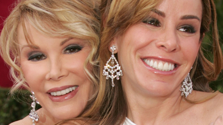 Joan and Melissa Rivers smiling on the red carpet