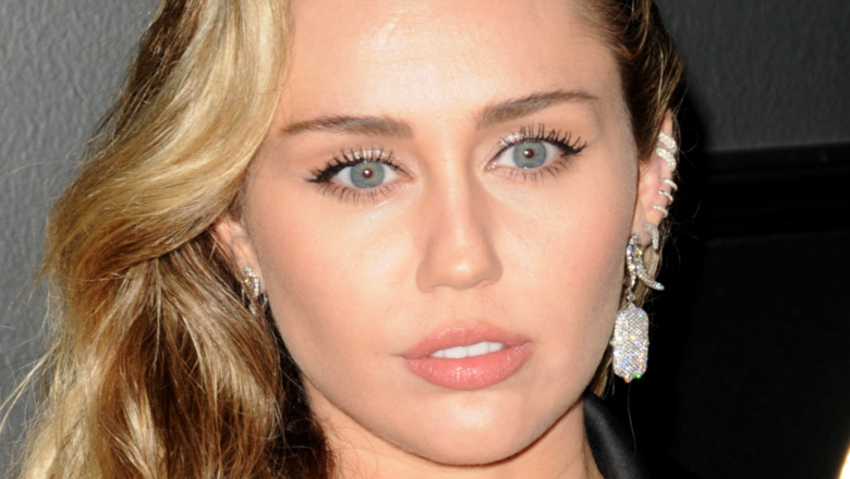 Miley Cyrus with a serious expression