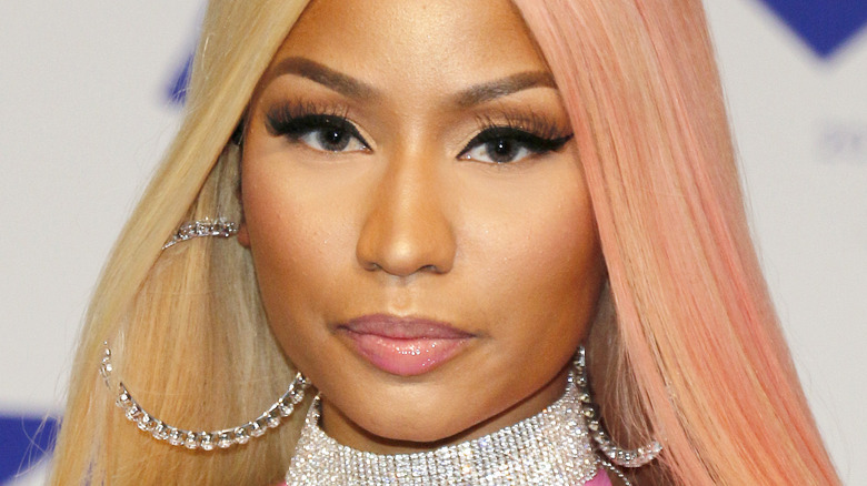 Nicki Minaj with serious expression on the red carpet