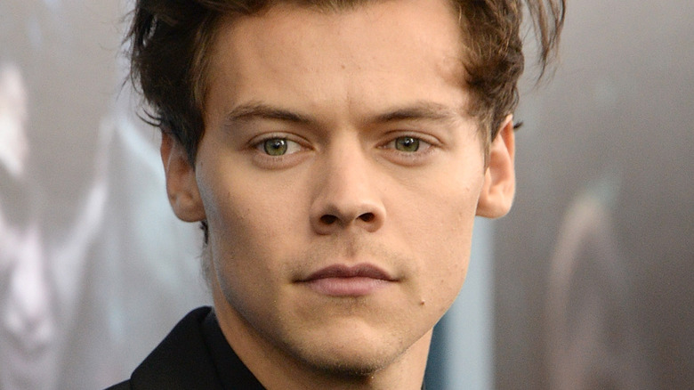 Harry Styles gives a serious stare