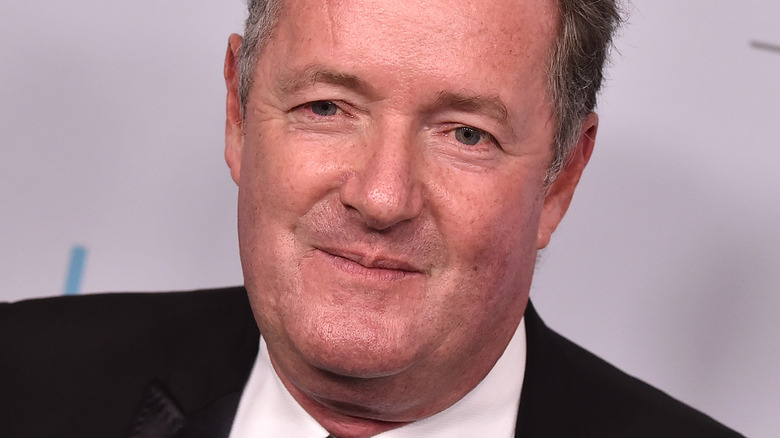 Piers Morgan with slight grin