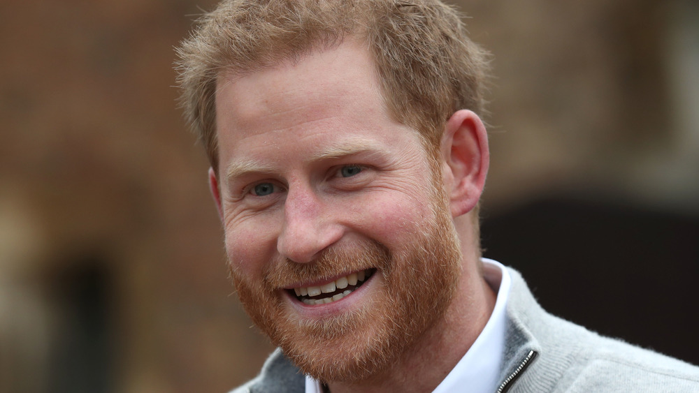 Prince Harry smiling at an event