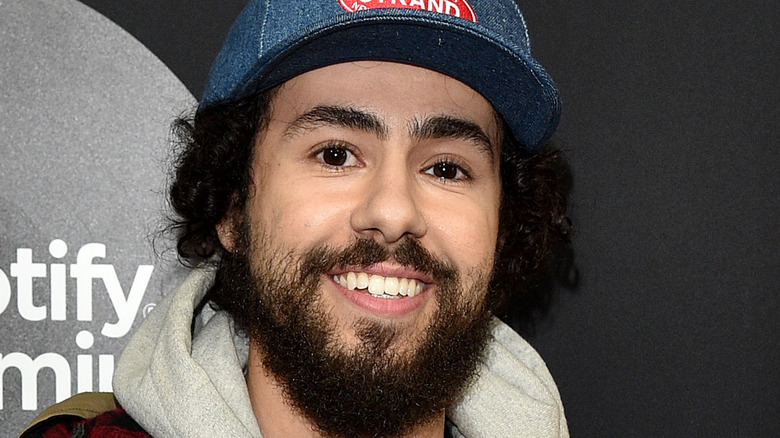 Ramy Youssef smiling hat