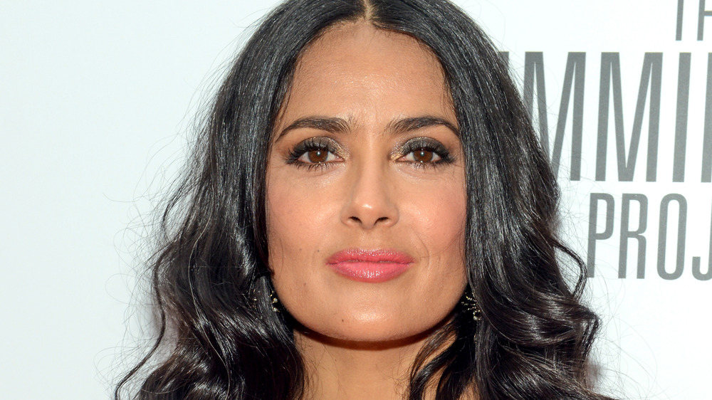 Salma Hayek posing on the red carpet at an event