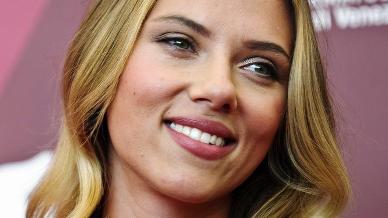 Scarlett Johansson smiling on the red carpet