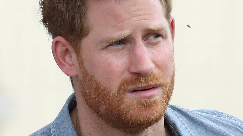 Prince Harry staring with a serious expression