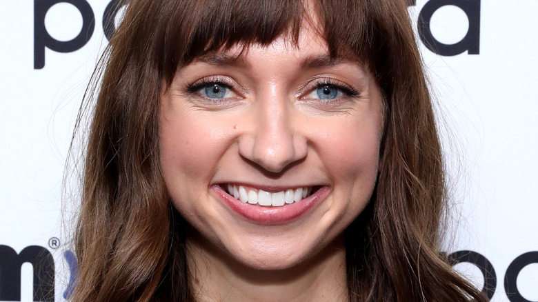 Lauren Lapkus smiling with bangs