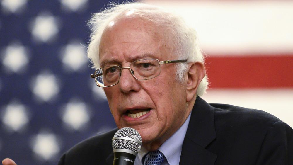 Bernie Sanders talking into a microphone