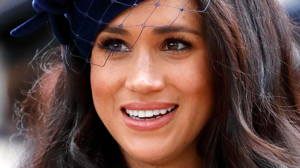 Meghan Markle wears a blue hat