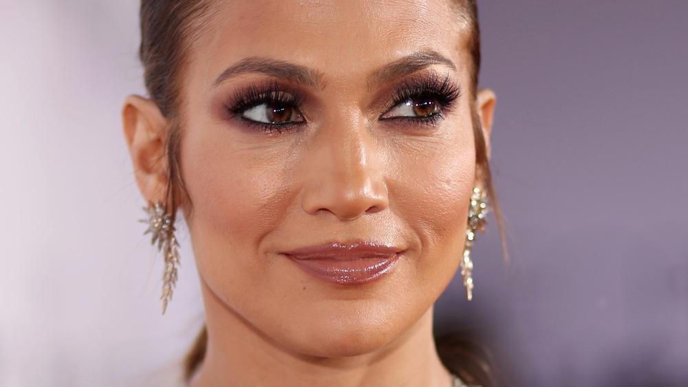 Jennifer Lopez smiling on the red carpet