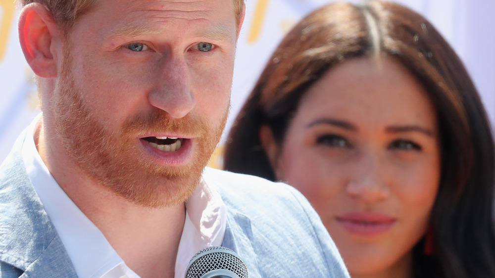 Prince Harry and Meghan Markle talking