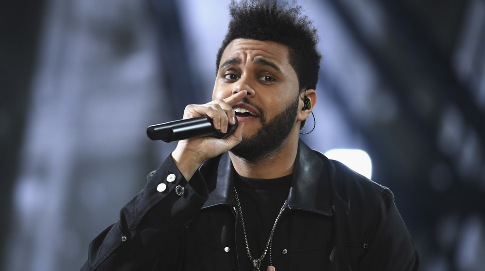 The Weeknd performing on stage at a concert