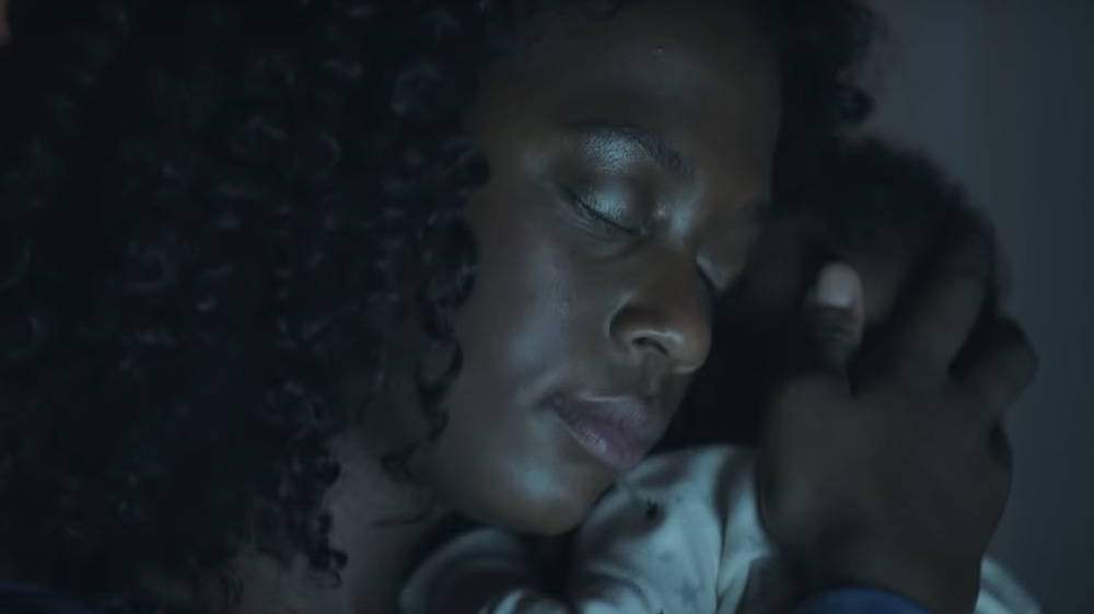 Mother cuddling baby in Frida Mom commercial