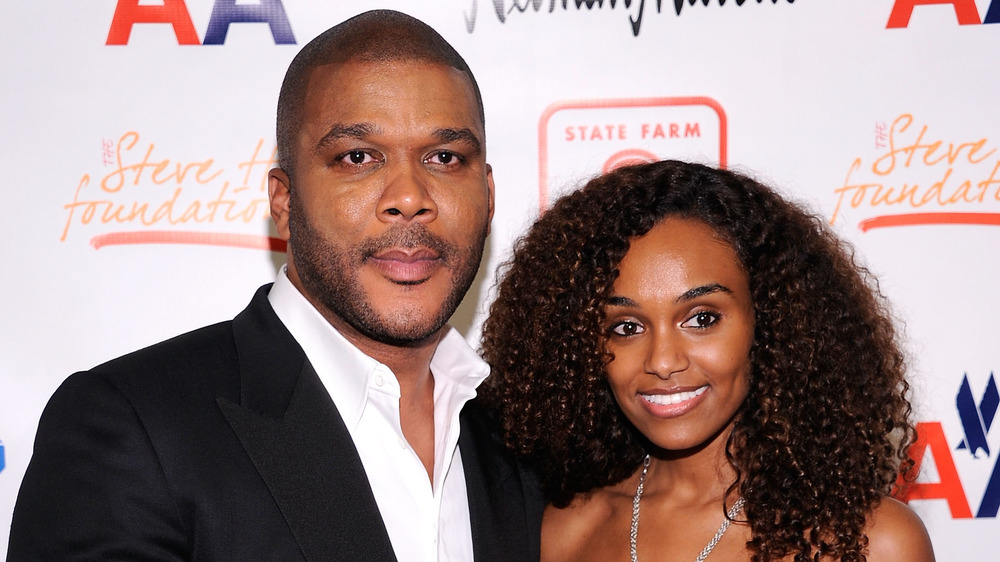 Tyler Perry and Gelila Bekele posing on a red carpet