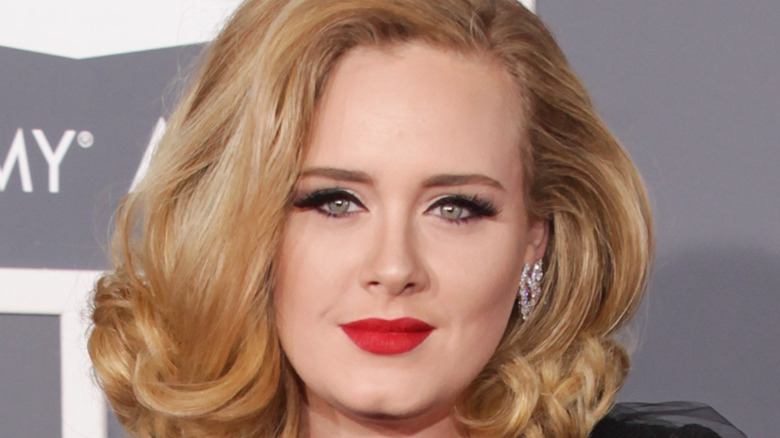 Adele smiles in red lipstick