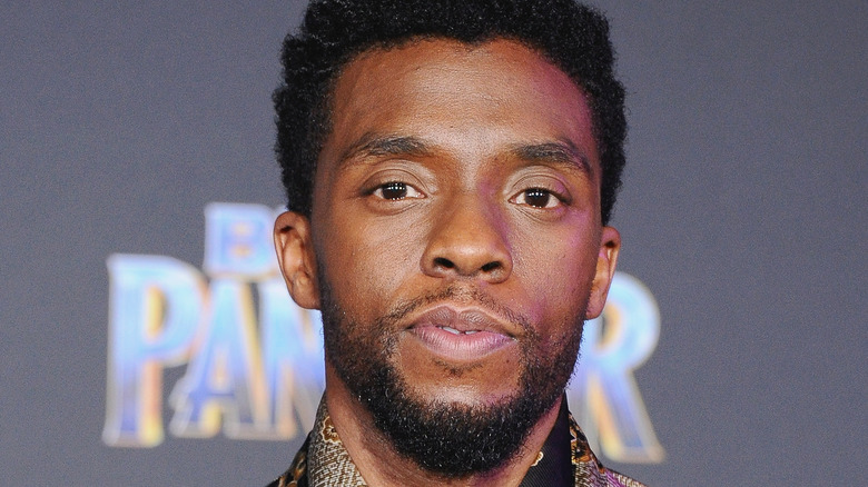 """Chadwick Boseman, half smiling, 2018 event photo for """"Black Panther'"""