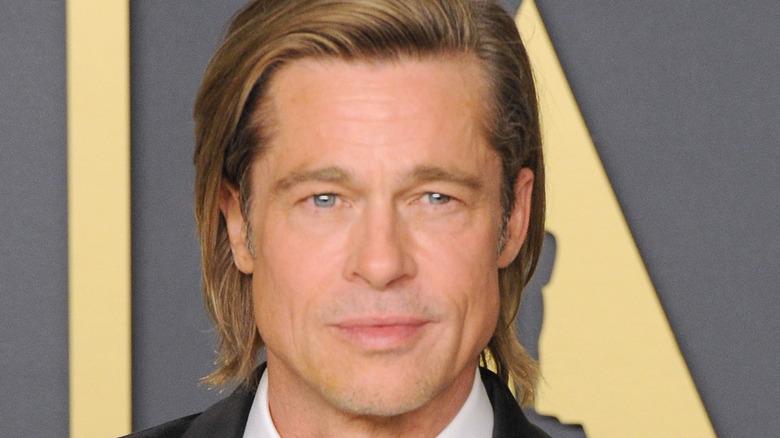 Brad Pitt looks on