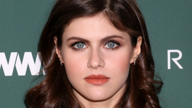 Alexandra Daddario on the red carpet with serious expression