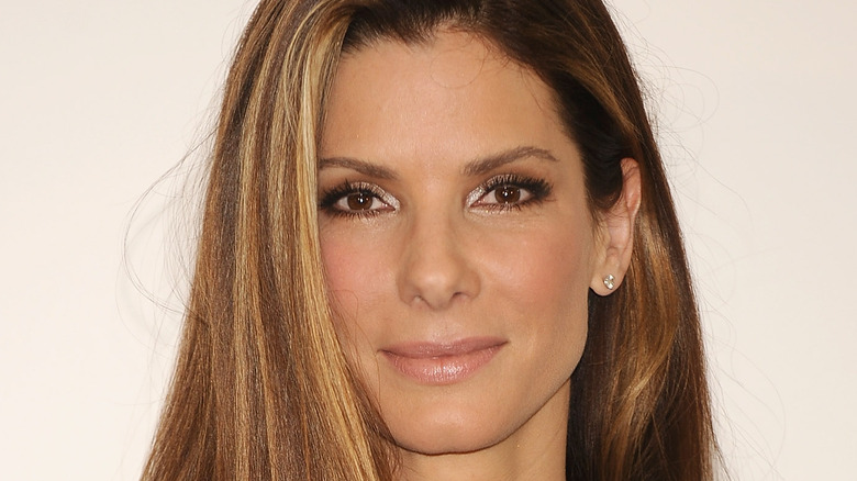 Sandra Bullock smiles on the red carpet for the premiere of The Proposal in 2009