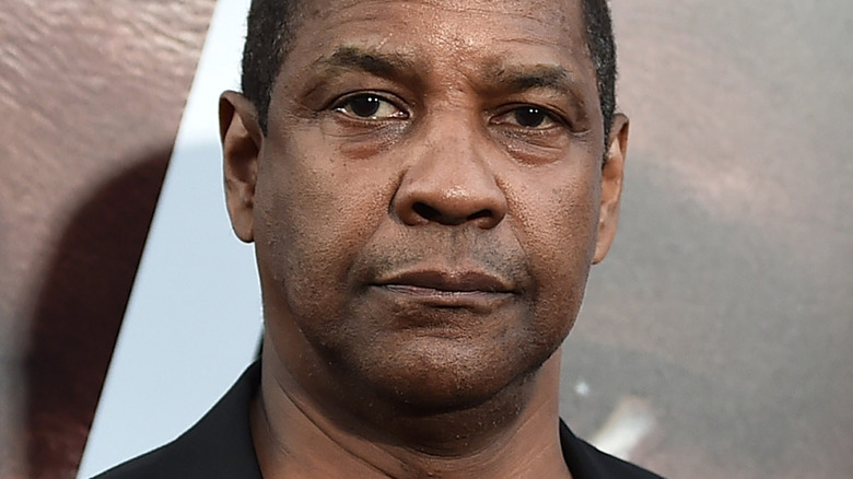 Denzel Washington looking serious on the red carpet