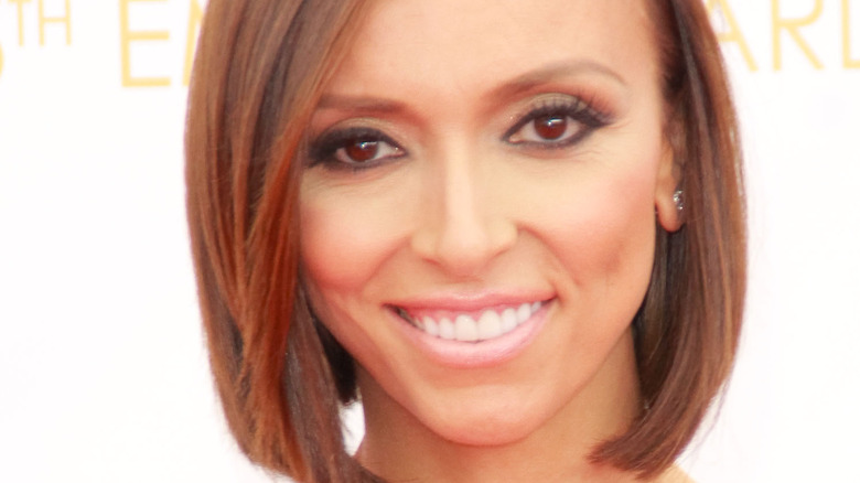 Giuliana Rancic smiling on red carpet at the Emmys