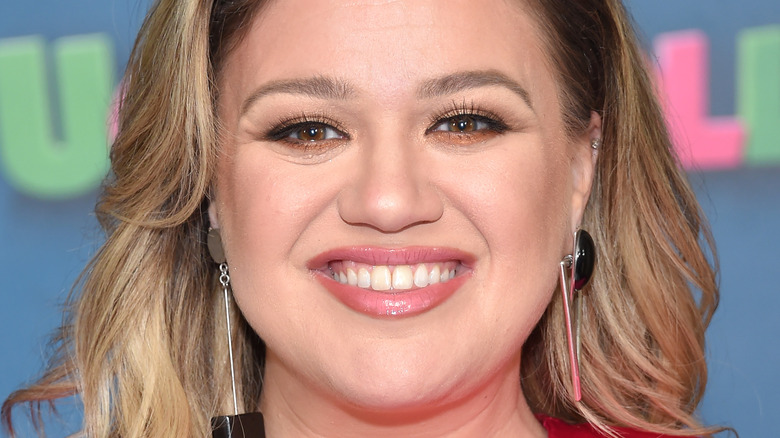 Kelly Clarkson smiling at an event