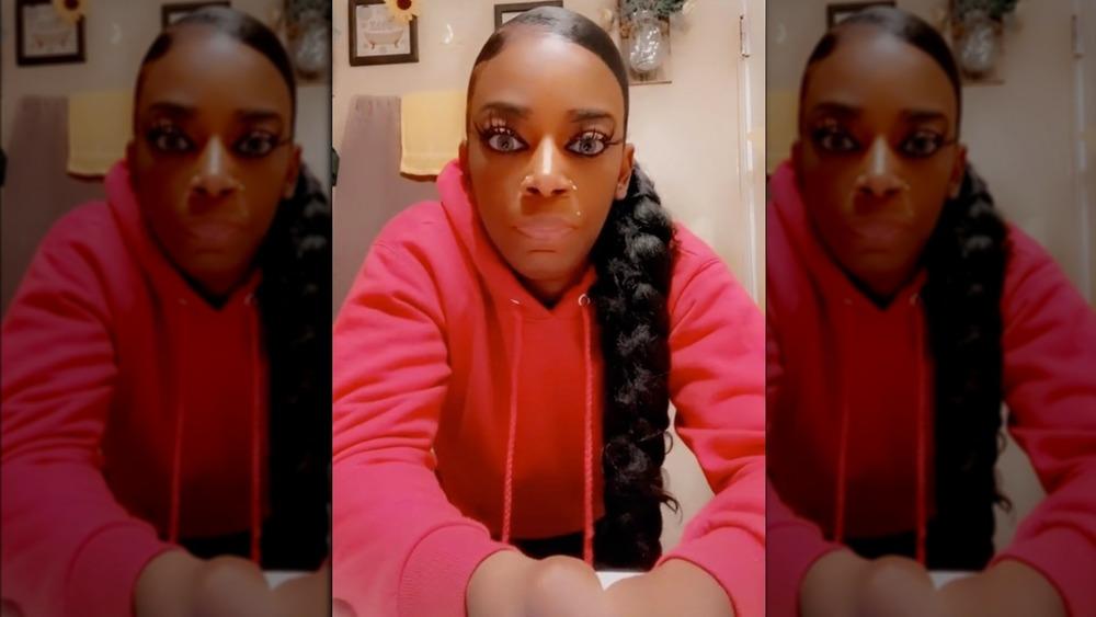 Tessica Brown wears glued hair